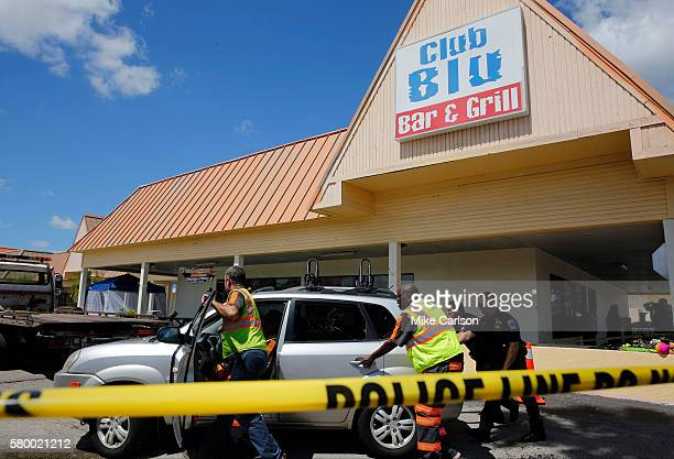 Police remove a car hit by gunfire outside of Club Blu where two people were killed and at least 15 wounded on July 25 2016 in Fort Myers Florida...