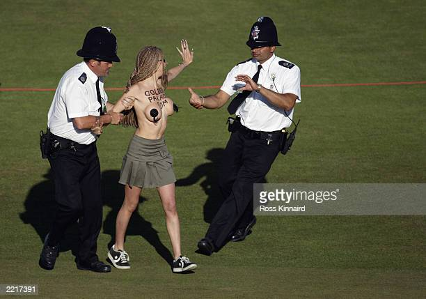 Police remove a streaker from the 18th green during the final round of the Open Championship at the Royal St George's course on July 20 2003 in...