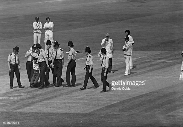 Police remove a Tamil demonstrator from the pitch during a Cricket World Cup Group B match between Australia and Sri Lanka at the Oval London 11th...
