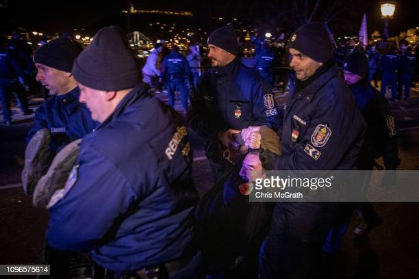 Police remove demonstrators sitting on Budapest's famous Szechenyi Chain Bridge after police blocked them from leaving after attending a...