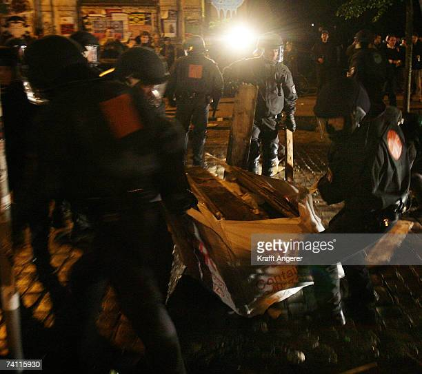 Police remove parts of a street blockade during a demonstration in front of the Rote Flora a stronghold of G8 opponents on May 9 2007 in Hamburg...