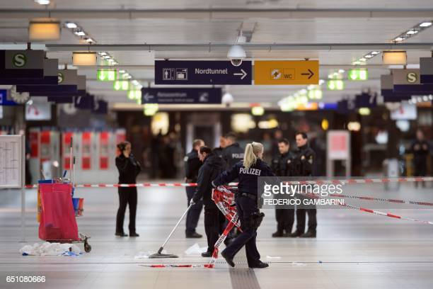 Police remove security cordons at the main train station of Duesseldorf western Germany on March 10 one day after German police have arrested an...