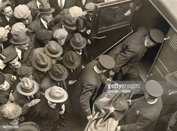 Police remove the body of gangster Dean 'Dion' O'Banion from his Schofield Co florist shop at 738 N State Street in Chicago on Nov 10 1924 Three...