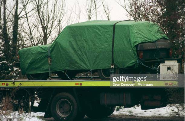 Police remove the Range Rover car in which three bodies were found by a farmer on the back of low loader The three men aged 2040 who died of gunshot...