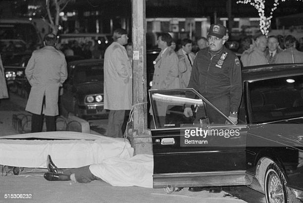 Police removed the bloodcovered body of reputed Boss of Bosses Paul C Big Paul Castellano from the crime scene after he and his driver were gunned...