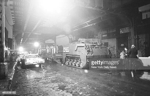 Police rescue ambulance a converted armored personnel carrier moves into position near John and Al sporting goods shop