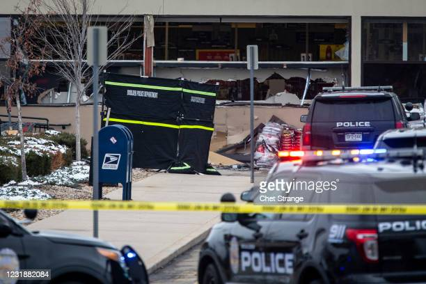 Police respond after a gunman opened fire at a King Sooper's grocery store on March 22, 2021 in Boulder, Colorado. Ten people, including a police...