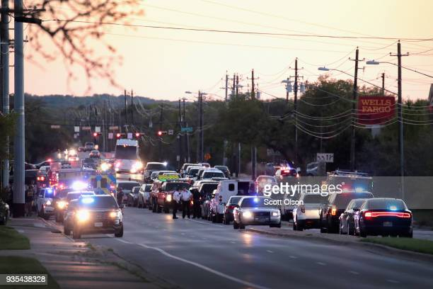 Police respond after one person was injured by a package containing an incendiary device at a nearby Goodwill store on March 20 2018 in Austin Texas...