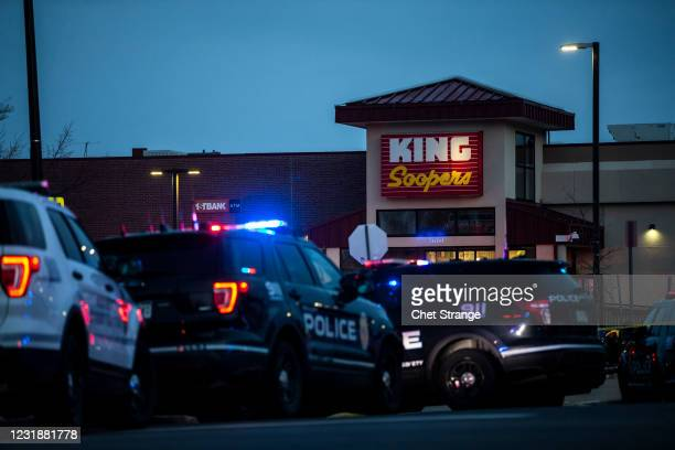Police respond at a King Sooper's grocery store where a gunman opened fire on March 22, 2021 in Boulder, Colorado. Ten people, including a police...