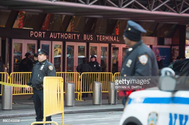 Police respond to a reported explosion at the Port Authority Bus Terminal on December 11 2017 in New York New York police said Monday that they were...