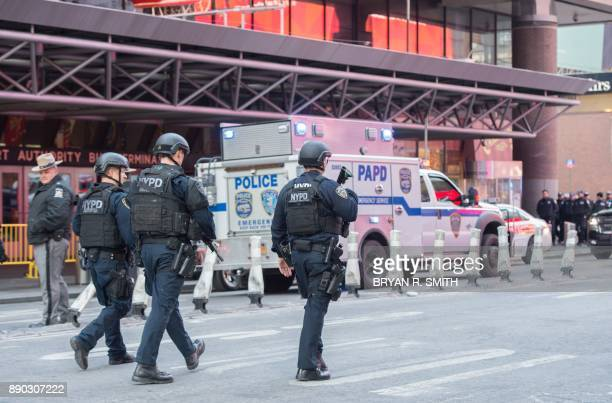 Police respond to a reported explosion at the Port Authority Bus Terminal on December 11 2017 in New York Four people were injured Monday in the...