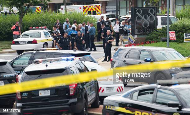 Police respond to a shooting at the offices of the Capital Gazette a daily newspaper in Annapolis Maryland June 28 2018 The local ABC7 news reported...