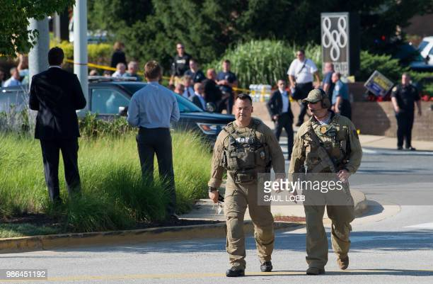 Police respond to a shooting in Annapolis Maryland June 28 2018 At least five people were killed Thursday when a gunman opened fire inside the...