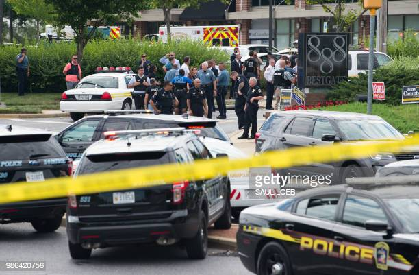 TOPSHOT Police respond to a shooting in Annapolis Maryland June 28 2018 Several people were feared killed Thursday in a shooting at the building that...