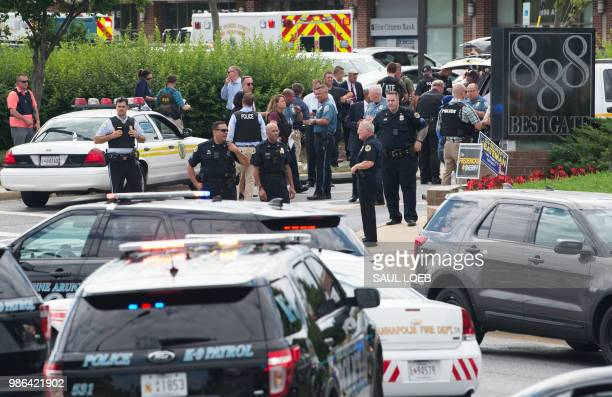 Police respond to a shooting in Annapolis Maryland June 28 2018 Several people were feared killed Thursday in a shooting at the building that houses...
