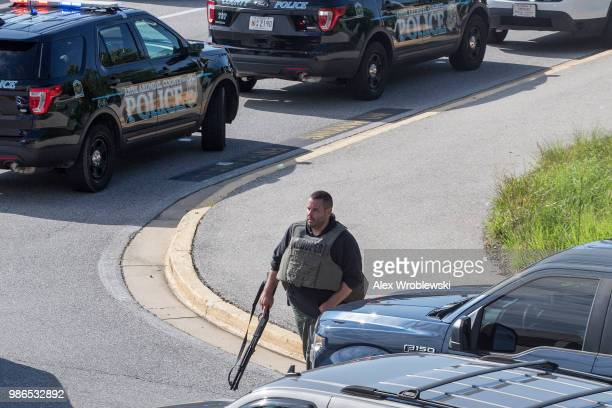 Police respond to a shooting on June 28 2018 in Annapolis Maryland At least five people were killed Thursday when a gunman opened fire inside the...