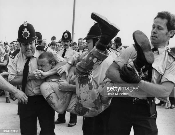 Police restraining a skinhead during a disturbance in SouthendonSea Essex 1st September 1981