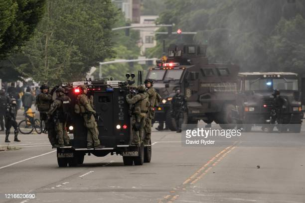 Police ride on an armored vehicle on May 31 2020 in Bellevue Washington Protests due to the recent death of George Floyd took place in Bellevue in...