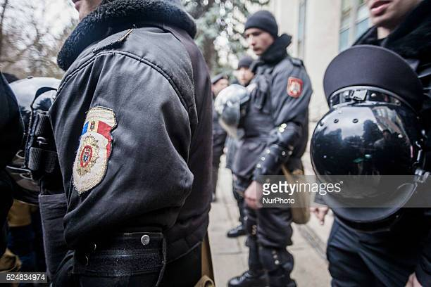 Police riot keeps guard in the main entrance of the government building of the Republic of Moldova during a demonstration in Chisinau claiming for...