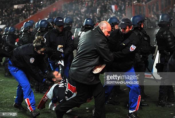Police riot officers arrest a Paris SaintGermain's fan during French L1 football match Paris SaintGermain v Olympique de Marseille's at Parc des...