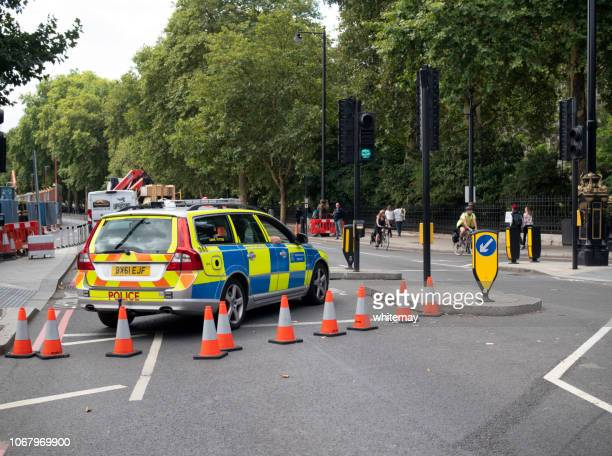 police road-block on london's victoria embankment - cordon boundary stock pictures, royalty-free photos & images
