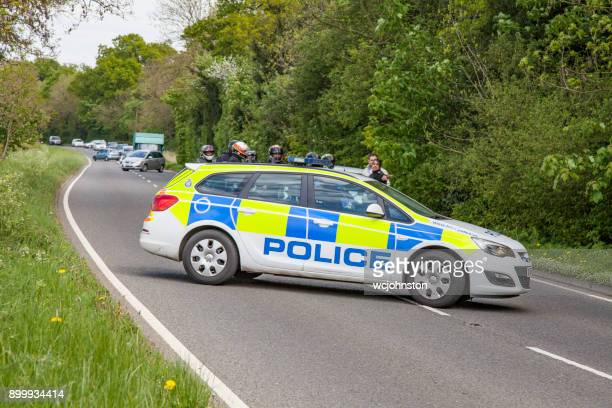 police roadblock - police car stock photos and pictures