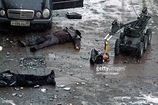 A police robot examines dead bodies outside the hotel 'National' opposite the Kremlin in down town Moscow 09 December 2003 Six people were killed and...