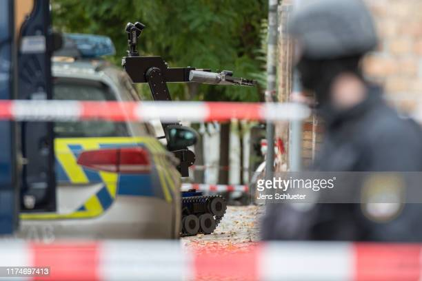 A police robot near the scene of a shooting that has left two people dead on October 9 2019 in Halle Germany Law enforcement authorities after...