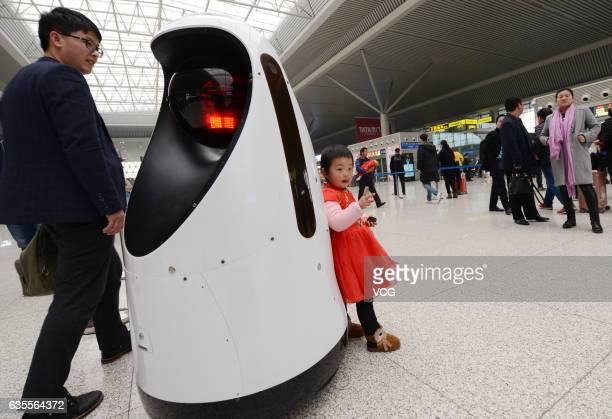 A police robot patrols at Zhengzhou East Railway Station on February 15 2017 in Zhengzhou Henan Province of China The police robot can do the...