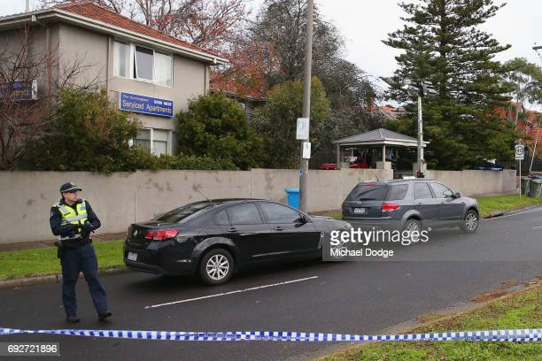 Police rope off service apartments on June 6 2017 in Melbourne Australia Police are treating an incident where an armed man shot and killed a man and...