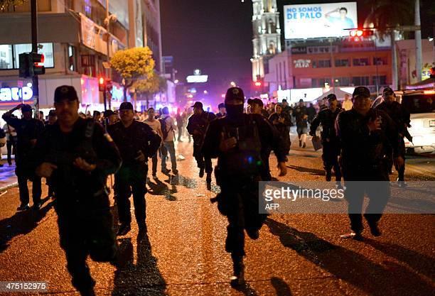 Police run to break up a protest in support of Mexican drug kingpin Joaquin Guzman Loera aka el Chapo Guzman in Culiacan Sinaloa State Mexico on...