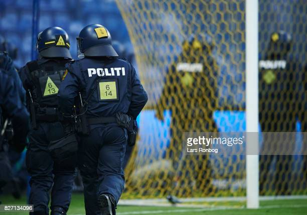 Police running on to the pitch due to riots among the fans of FC Copenhagen during the Danish Alka Superliga match between Brondby IF and FC...