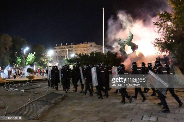 Police runs towards protesters outside the National Assembly building in Belgrade, on July 10 during clashes at a demonstration against a weekend...