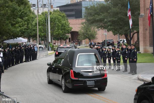 Police salute as the remains of former first lady Barbara Bush leave St Martin's Episcopal Church following her funeral service on April 21 2018 in...