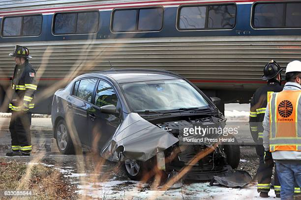 Police say this Nissan Sentra collided with Amtrak's Downeaster after trying to beat the crossing gates Friday morning on Brighton Avenue