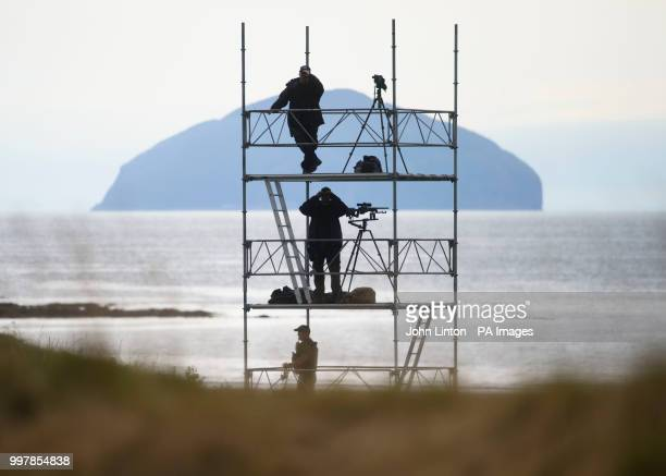 Police scan the golf course at Trump Turnberry resort in South Ayrshire backdropped by Ailsa Craig island as the US President Donald Trump is...