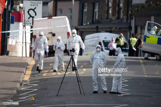 Police scene of crime officers on Tylacelyn Road on May 5 2020 in Penygraig United Kingdom A person is understood to have died and four others are...