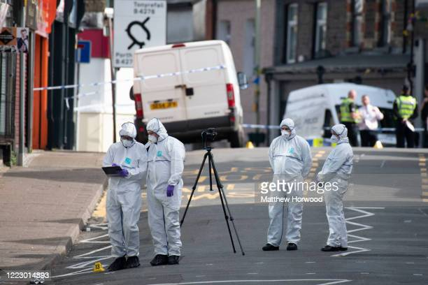 Police scene of crime officers on Tylacelyn Road on May 5, 2020 in Penygraig, United Kingdom. A person is understood to have died and four others are...