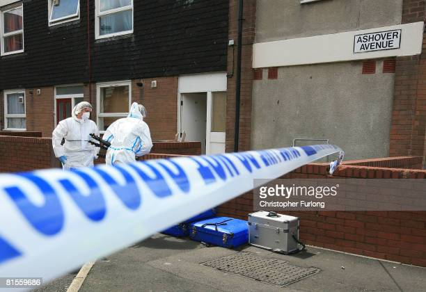 Police scene of crime officers work outside a house in Ashover Avenue where a 16yearold girl was shot in the head and critically injured on 14 June...