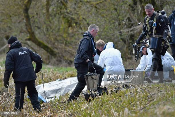 Police Scotland divers, search a canal stretch for an eleven year old schoolgirl Moira Anderson on March 20, 2017 in Coatbridge, Scotland. Police are...