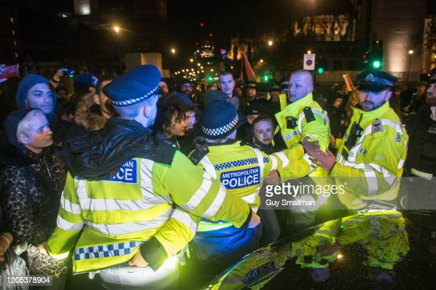 Police scuffle with protestors whom were blocking a VIP car believed to contain a government member on February 10 2020 in London England Protestors...