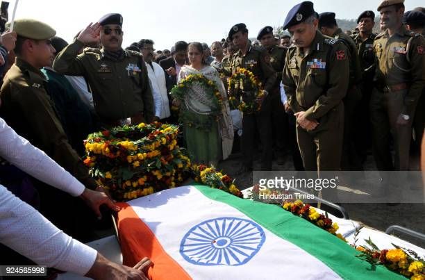 IG police SDS Jamwal pays tribute to police constable Kultar Singh during his funeral on February 26 2018 in Jammu India Kultar Singh was shot dead...