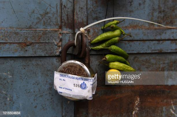 TOPSHOT A police seal is seen on a padlock of a shop near the Red Fort area on the old quarters of New Delhi on August 12 as security measures...