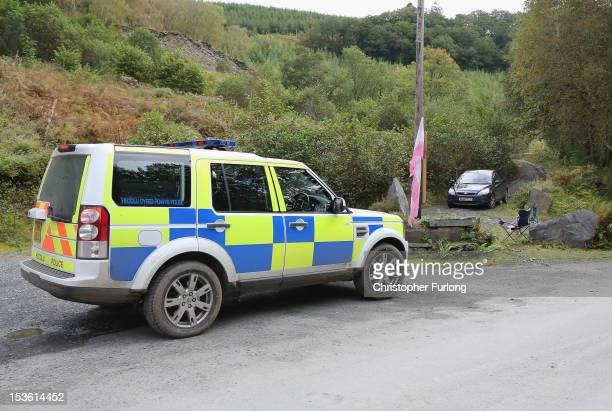 Police seal off the entrance to a quarry near to the home of Mark Bridger in the village of Ceinws as the search for missing April Jones continues on...