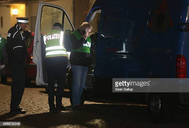 Police search a van after they arrested two men at the van in Britz district earlier in the day on November 26 2015 in Berlin Germany According to a...