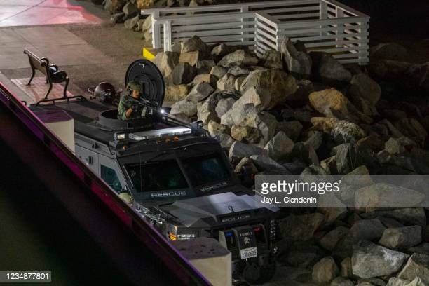 Police search for a suspect involved in a shooting on Redondo Beach Pier on Wednesday, Aug. 25, 2021 in Redondo Beach, CA. Two people were injured...