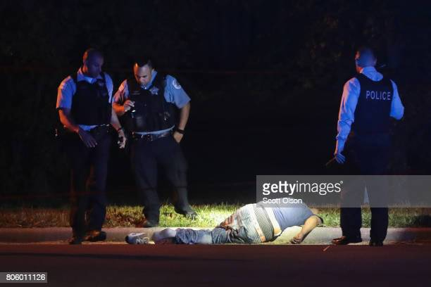 Police search for evidence after a man was found shot to death on the near west side on July 3 2017 in Chicago Illinois Five people were killed and...