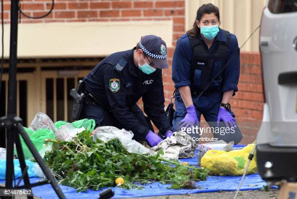 Police search for evidence at a block of flats in the Sydney suburb of Lakemba on July 31 after counterterrorism raids across the city on the weekend...