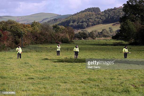 Police search in fields close to where Mark Bridger was arrested on October 3 2012 near Machynlleth Wales Fiveyearold April Jones was abducted from...