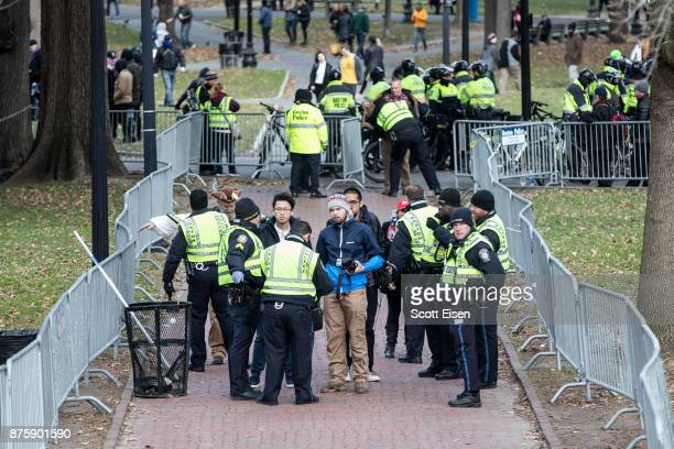 Police search people endering a secured area where an AltRight organized free speech event was taking place on the Boston Common on November 18 2017...